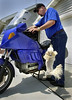 When I hit the starter button, buddy is jumping to get on the motor bike.     Photo Credit to the Milwaukee Journal newspaper.